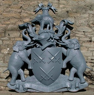 The primed moulded coat of arms