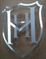 Heathfield School sign. Formed from stainless steel components, shaped and overlapped.