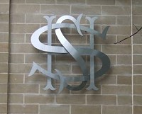 Sheffield High School sign. Formed out of stainless steel cut-out components, curved and intertwined.