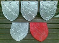 Cast aluminium shields for Exeter College Oxford.