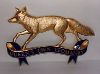 Queen's Own Yeomanry military badge, approximately 36in wide, with gold leaf finish.