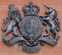 7ft 5in/2.25m high British royal coat of arms GRP/cold-cast aluminium Manchester Magistrates' Court.